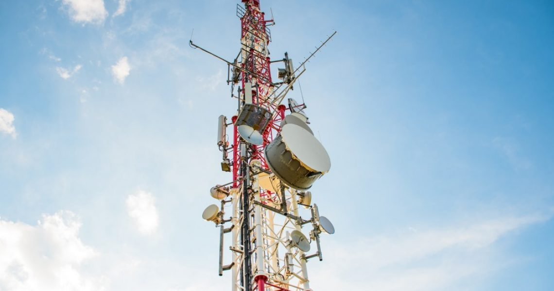 red-and-white-metal-construction-of-a-network-base-tower-communications-mast-with-repeaters-and_t20_axaXeQ